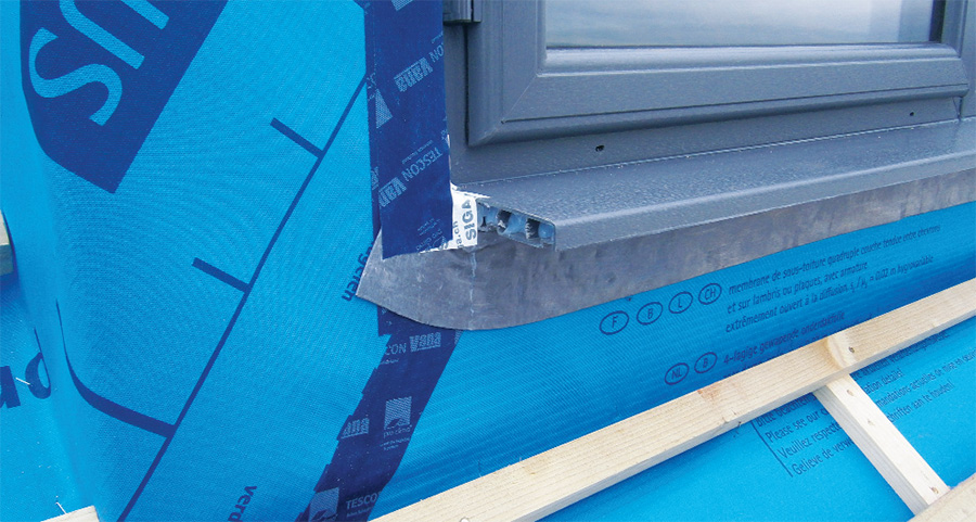 Wind-tightness detailing around windows and the insulated window cills