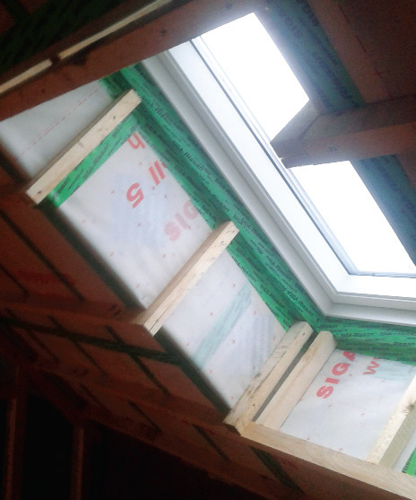 Airtightness detailing with Siga tapes and membranes around the Velux roof window