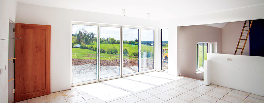 Reynaer's aluminium bi-fold doors, triple-glazed with argon filling and an overall U-value of 1.0 W/m2K