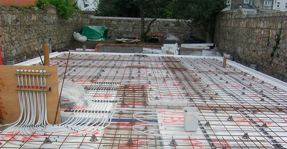 Installation almost complete of the reinforced steel mesh for the concrete slab, with underfloor heating also installed