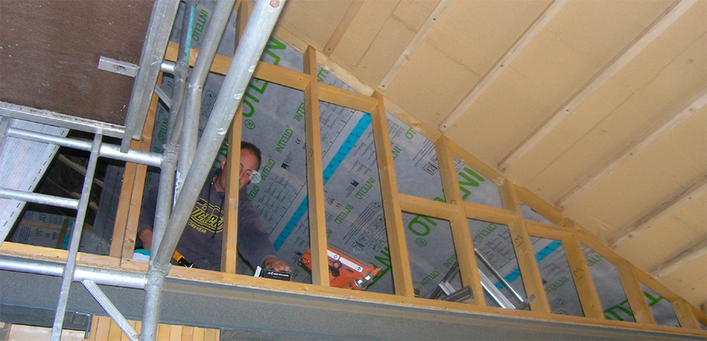 Intello vapour barrier and Gutex Ultratherm insulation fixed to underside of roof beams