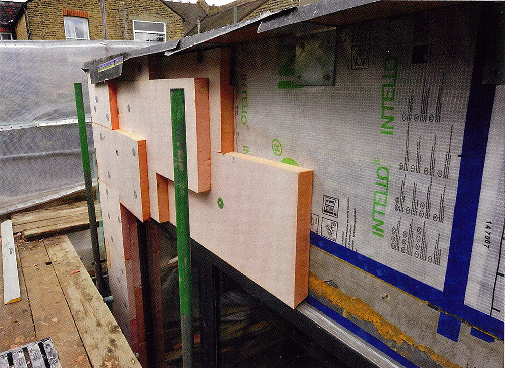 Wall build-up showing Intello airtightness membrane, which was used in places to ensure airtightness, followed outside by a Wetherby external insulation system