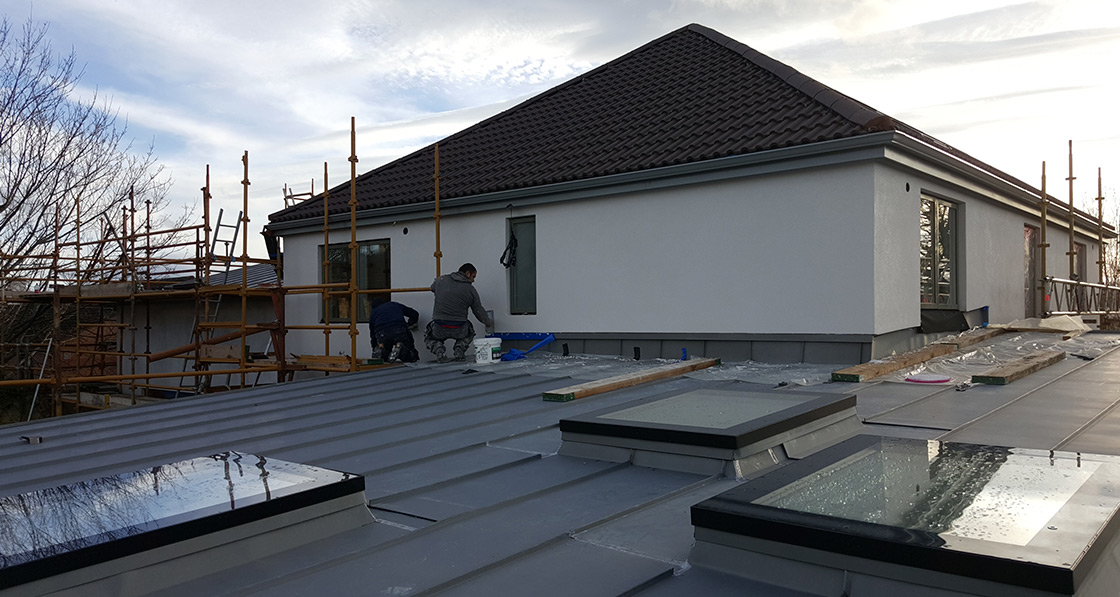 The house was wrapped with a Baumit external wall insulation system, with VM Zinc roofing and Fakro DXF triple glazed roof windows