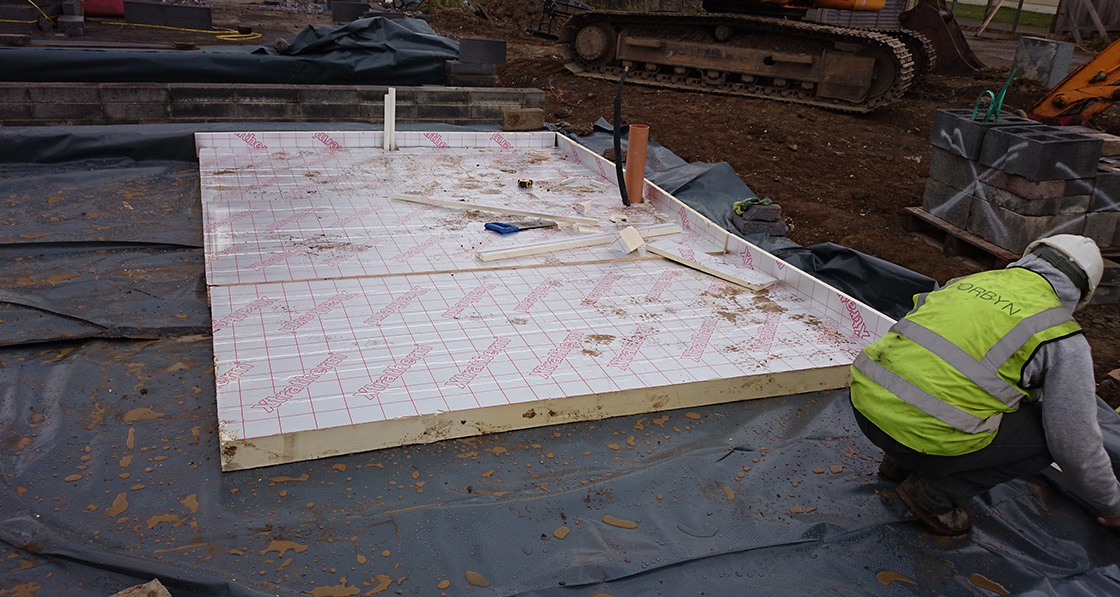 The ground floor features 150mm of Xtratherm insulation under the concrete slab and 100mm Xtratherm as an upstand to the inside of the blockwork around the entire perimeter to reduce thermal bridging.