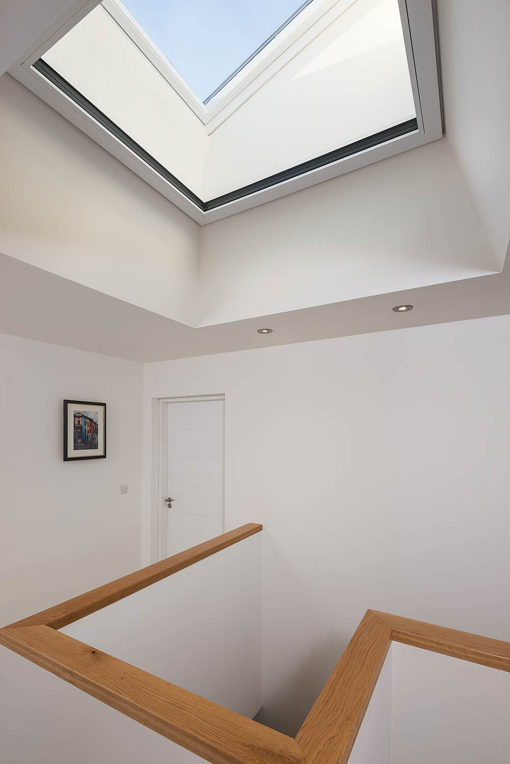 The house features a double-glazed Velux roof window for natural light, with a triple-glazed Munster Joinery Passiv Aluclad window lying horizontal underneath this near the top of the insulation layer