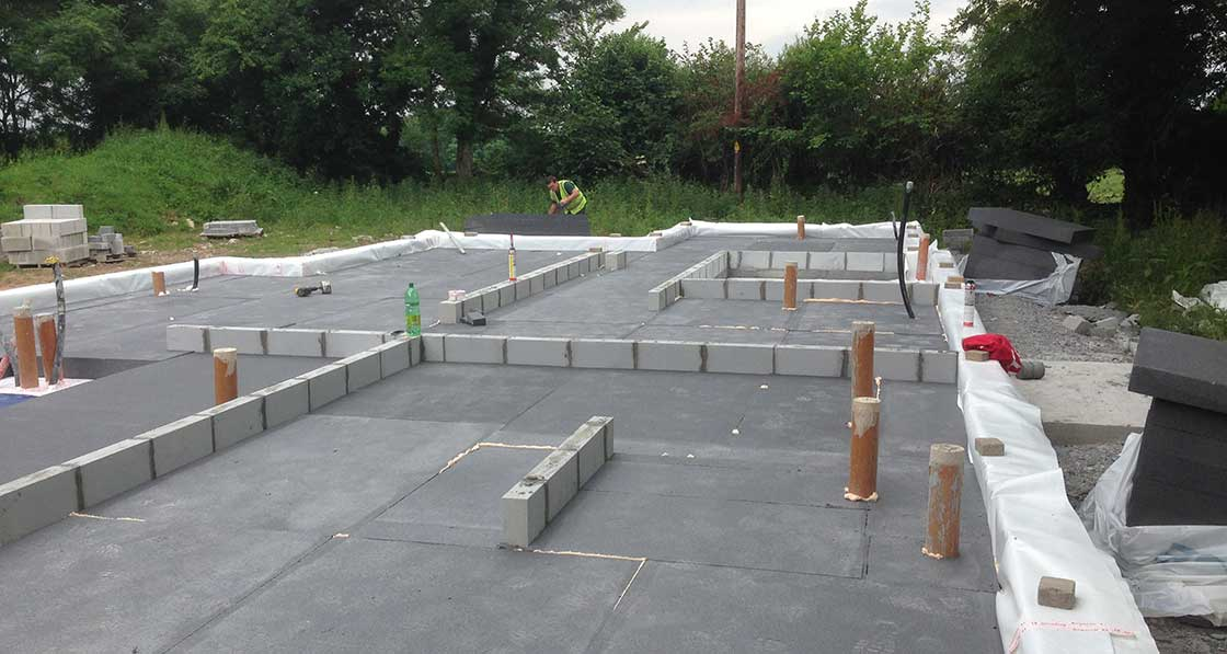 Raft foundation insulated with 250mm Kore Insulation, and 215mm Quinn Lite blocks to perimeter and rising walls