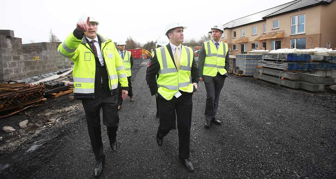 (L-r) A site visit with Patrick Durkan, Department of Housing advisor Seán Armstrong, Minister of State for Housing Damien English and Electric Ireland general manager Paul Stapleton.