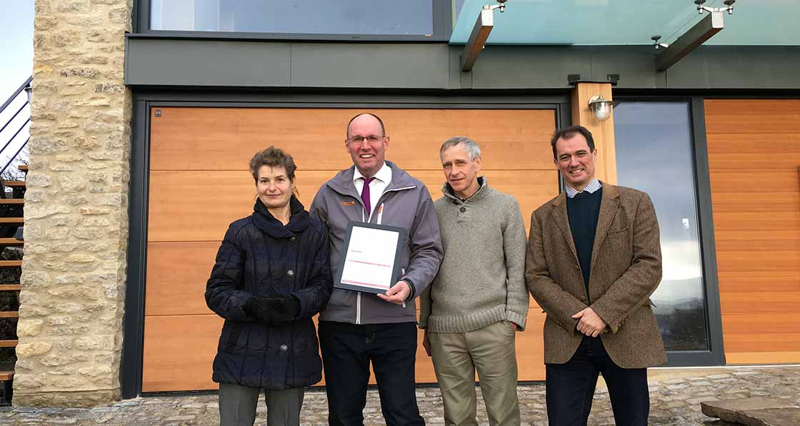 Handing over the certificate for reaching the new passive house plus standard, pictured are (l-r) Ruth Barnett, Ecowin MD Thomas Froehlich, Peter Richardson, and Adam Clark of Halliday Clark Architects.
