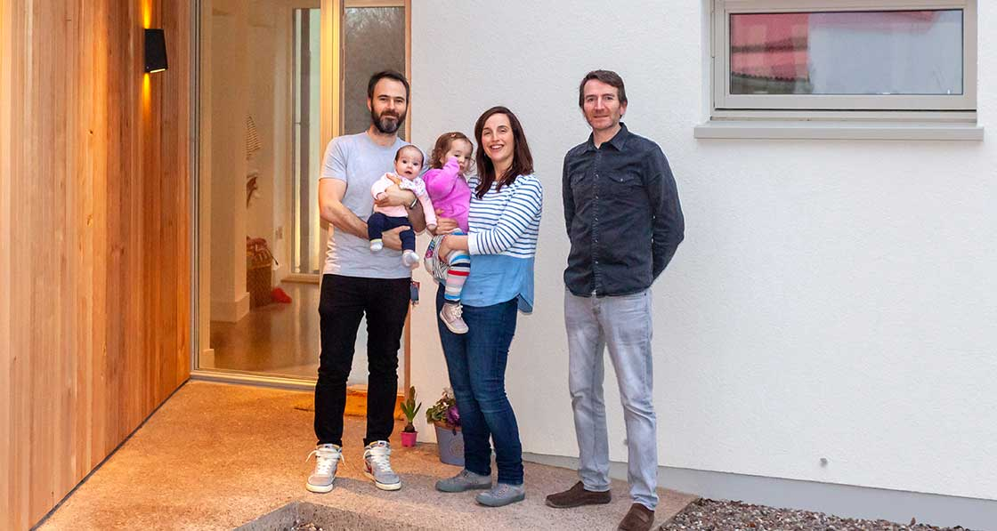 Happy homeowners Oliver Long, Aisling Buckley & family with architect Neil Kane