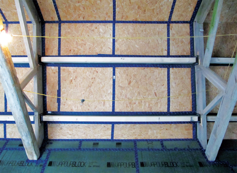 The Spano boards in the walls line up with OSB in the roof — which is taped with Pro-Clima tapes — to create a continuous airtight layer