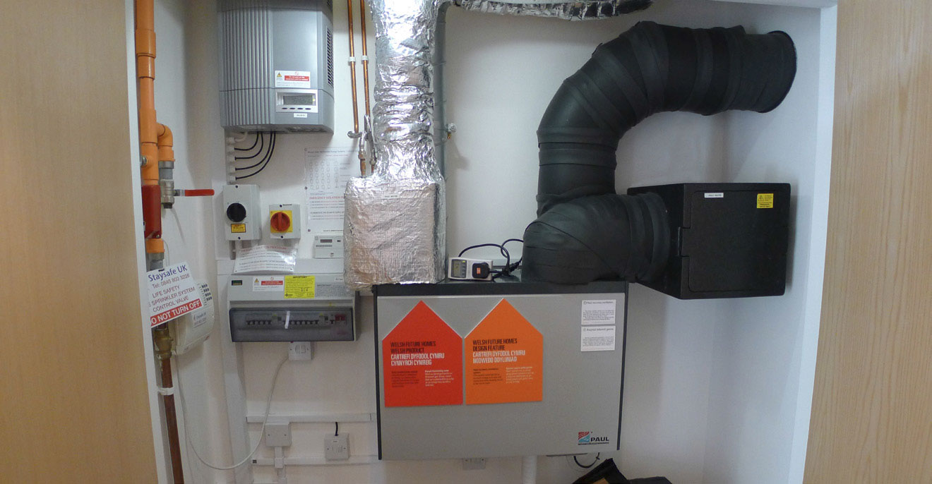 Neat and tidy installation of a Paul heat recovery ventilation system and associated equipment in Larch House, a Bere: Architects-designed passive house. Photo by Alan Clarke.
