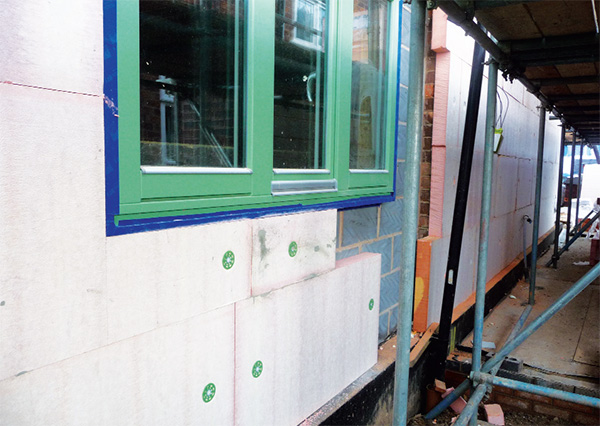 The house's external walls are insulated with a Permarock system including 180mm of phenolic foam insulation. Windows sit proud of the blockwork to ensure a continuous insulation layer.