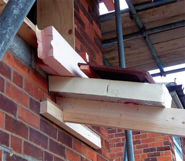 A wall to pitched roof insulation detail