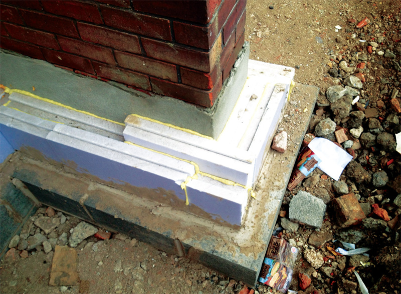 The careful application of external insulation begins