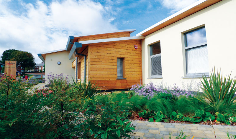 Different external insulation strategies were chosen for the building's timber clad and rendered sections