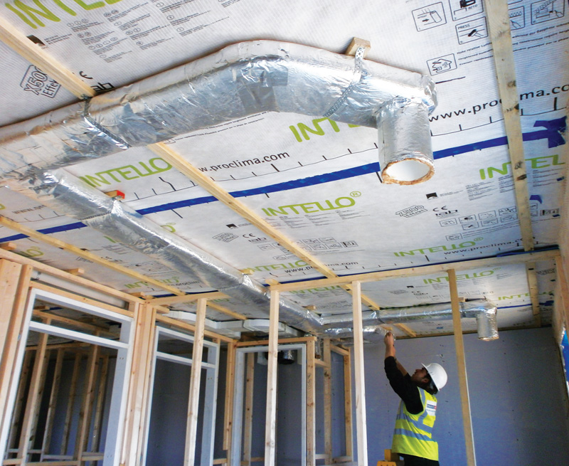Insulated ductwork for the mechanical heat recovery ventilation system and electrics for lighting are kept inside the airtight layer by a Gyproc MF suspended ceiling system