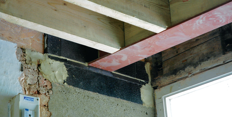 The joists are isolated from external walls in Perinsul blocks, with gaps left for internal insulation