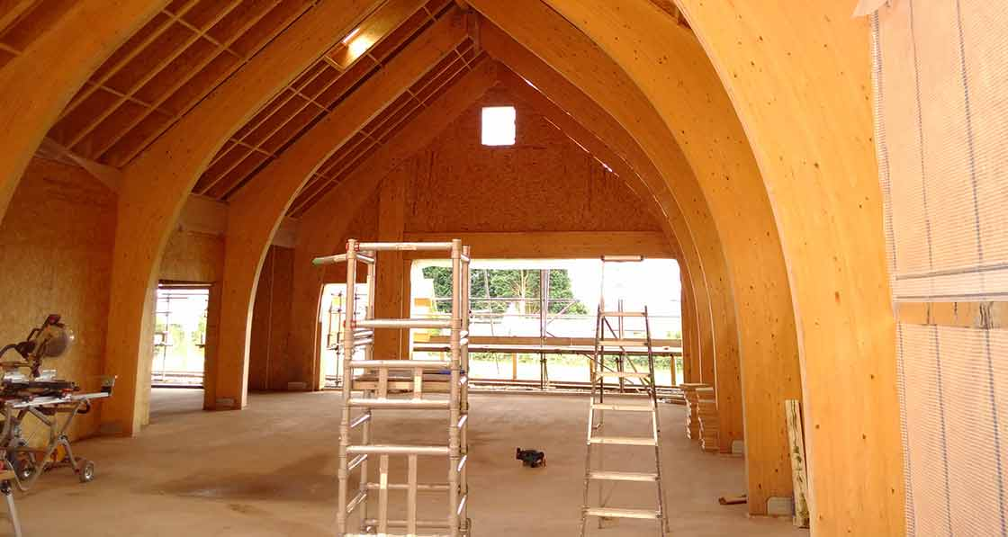 The building's glulam arch frame provides a striking architectural feature.