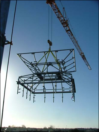 the stainless steel structure of the Venturi roof ventilator being lifted onto the building