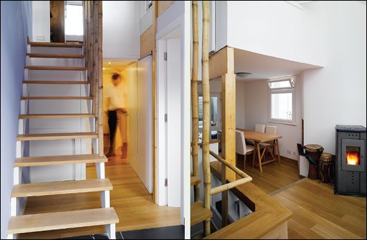 The ground floor hallway (left) with stairs leading to the main living area on the first floor. Bannisters are made from reclaimed bamboo; the main bedroom (right) is located in the converted attic