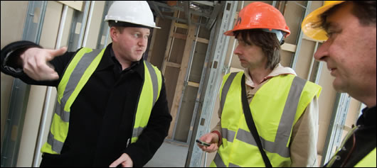 Diarmuid Hynes (left) and David Heffernan, founder of HAA (right) explaining the intricacies of the building to Construct Ireland's John Hearne (centre)