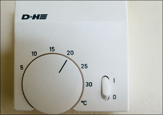 Thermostat which also controls opening and closing of windows in the stairwell, depending on the need for ventilation