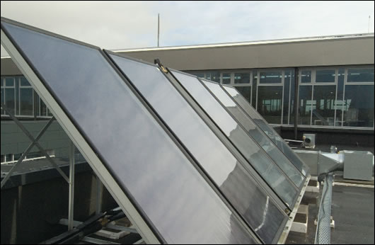 One of the decentralised flat plate solar arrays, which contribute towards domestic hot water supply, with a separate array for each department of the council