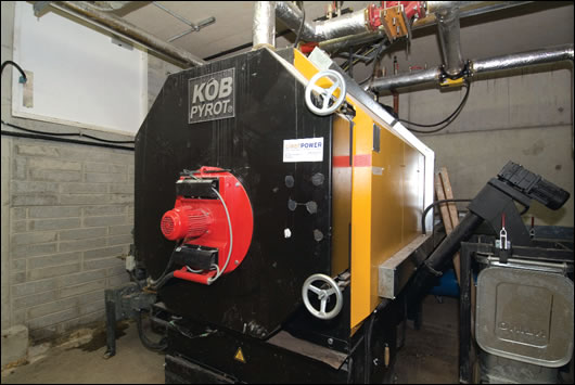 Primary heating comes from a KOB Pyrot 540kW woodchip boiler backed up by a 380kW gas boiler located in an underground boiler room, between the carpark and the eastern edge of the building