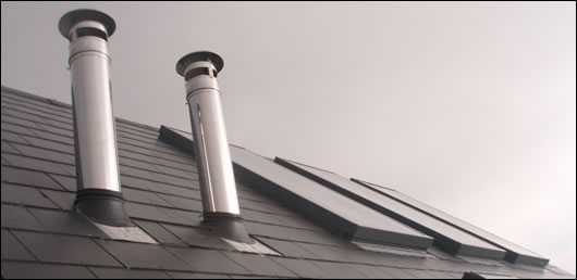 The insulated flue, supplied by Schiedel Chimney Systems, is brought through the house and terminates at a high level over the roof, ensuring that the flue will work well and that the residents should not experience bad odours outside the house