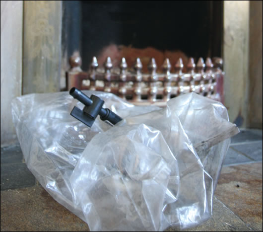 A chimney balloon, used to stop heat escaping up the chimney of the open fire