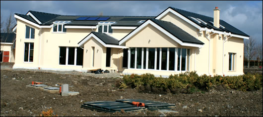 Wolf Passive Homes' show house in Kildare, (above) the front of which faces North whilst the rear (below) faces south and therefore includes substantially more glazing