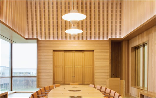 The main board room is one of the few parts of the building that is artificially ventilated, and is strikingly fitted out with FSC certified American Ash