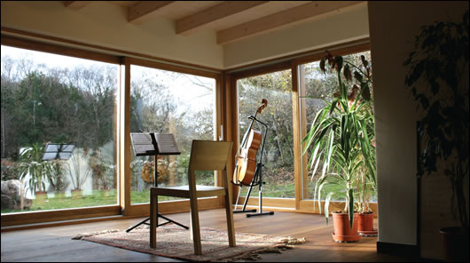 the music room faces south-west to maximise passive solar energy gain