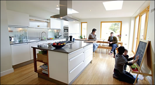 Javier Monedero, architect Paul McNally, Siobhan Egan and daughter relax in the renovated kitchen