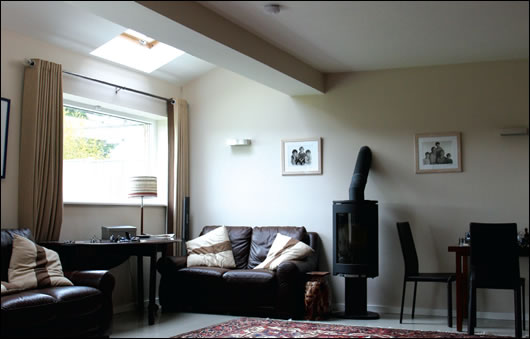 The spacious sitting room, like all of the ground floor, features underfloor heating