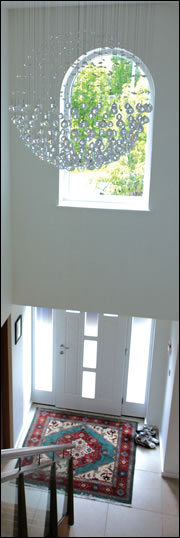 A double height entrance hall reduces the electrical lighting requirement