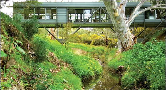 Fitting with the landscape is an often-overlooked part of green building, but the Bridge House does it beautifully