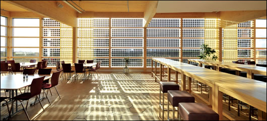 The triple-glazed canteen wall in which integrated crystalline solar cells provide the dual function of generating electricity and providing shading