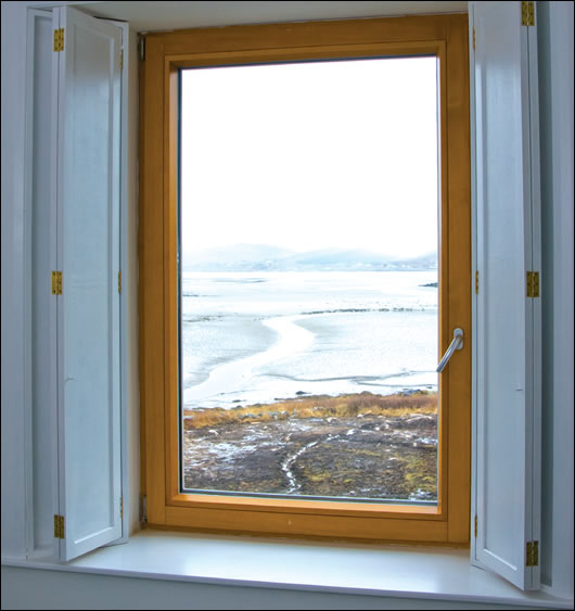 Large windows make the most of impressive views of the sea