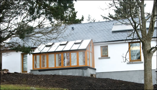 The south facing solar conservatory makes the most of passive solar gain