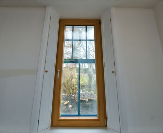 Old style wooden shutters were made and fitted by a local joiner, with triple-glazed uits installed inside the original windows