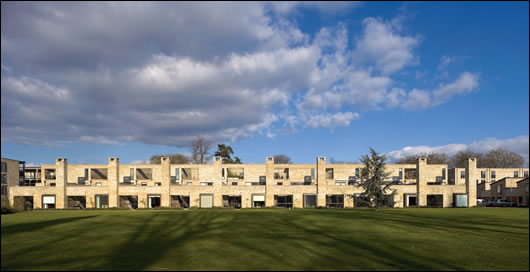 The development is set amidst large open areas and mature trees; UK-sourced Oak was used for balconies