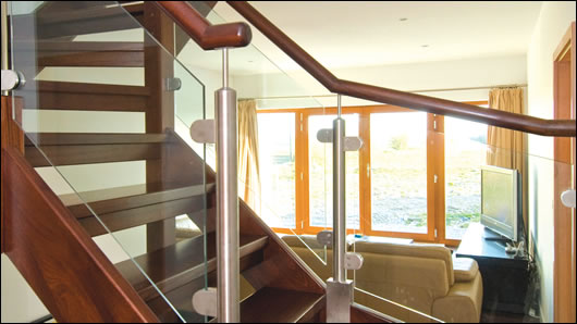 A timber staircase links the ground and first floor spaces, allowing heat to circulate through the house without fear of heat loss to the external