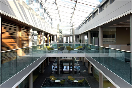 The offices are set around a large central atrium which aids ventilation and greatly increases natural light, with the added benefit of glazed balustrades