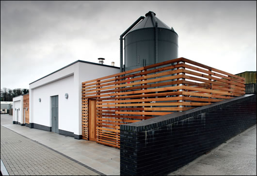 (above & below) The building's heating and hot water is supplied almost entirely by a biomass boiler with the pellet storage area and plant room located in the roof