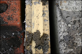 Partial-fill cavity wall construction, shown here with thermal performance severely compromised, is being used in innumerable cases where the application of more innovative systems and products is being obstructed