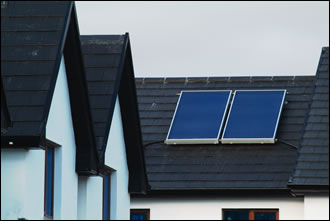 Two flat-plate solar panels on each roof look ater approximately 60% of annual hot water requirements