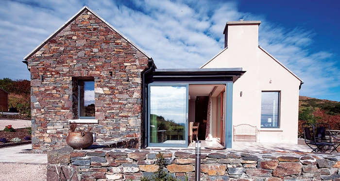 Traditional irish cottage looks to the future for Modern cottage house plans ireland