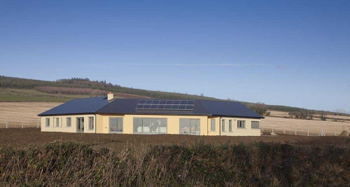 Ireland's first A1 rated certified passive house. In spite of installing a high efficiency heat pump, owner Francis Clauson felt compelled to install a solar PV array in order to meet the renewable energy targets in TGD L, as was revealed in issue two of Passive House Plus
