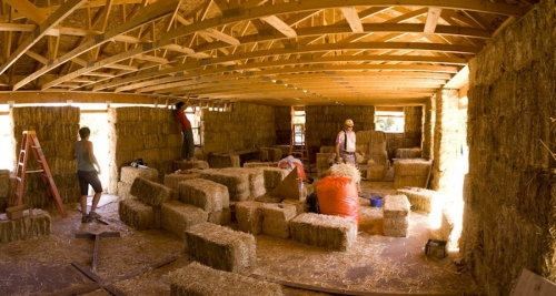 Straw bale building under construction